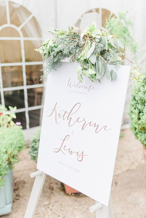 White Wedding Welcome sign with Gold Foil Font and White and Green Flower Decor