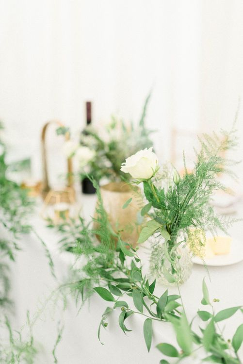 Foliage and White Flower Table Decorations