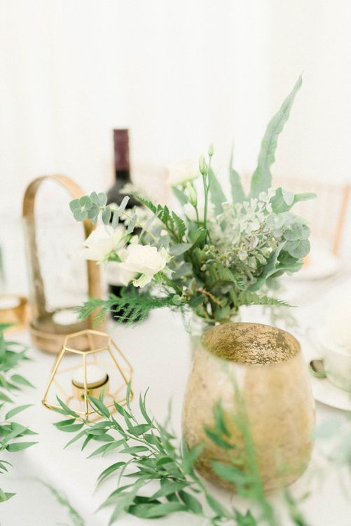 White and Green Wedding Flowers with Gold Vases and Geometric Candle Holders