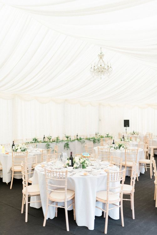 Elegant marquee Reception with Gold and Green Wedding Flowers