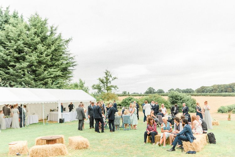 Outdoor Marquee Reception with Hay Bale Seating Area
