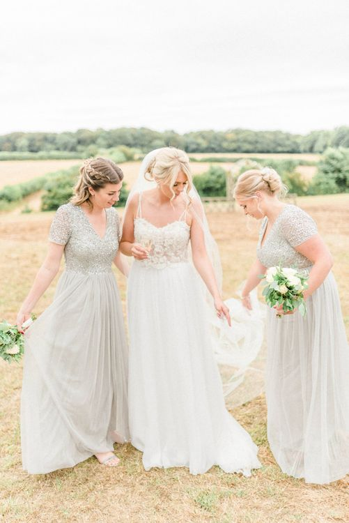 Bride in Lace Wedding Dress with Spaghetti Straps and Cathedral Veil and Bridesmaids in Maya Sequin Dresses