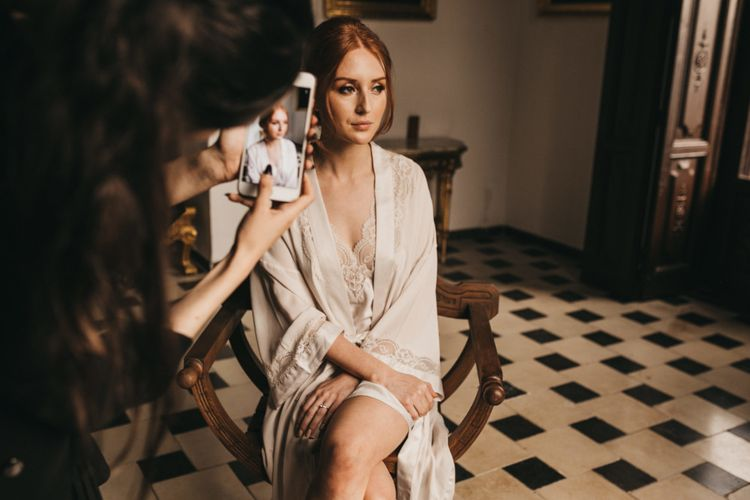 Wedding Morning Bridal Preparations with Bride in Lace Getting Ready Robe and Garter