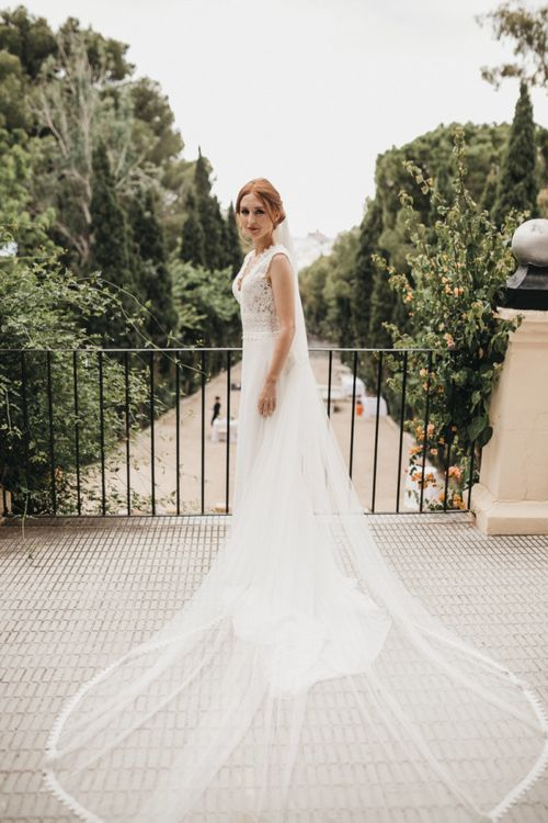 Bride in Pronovias Wedding Dress with Cathedral Length Veil
