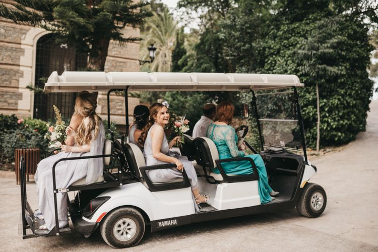 Bridal Party Travelling to the Ceremony in a Golf Buggy