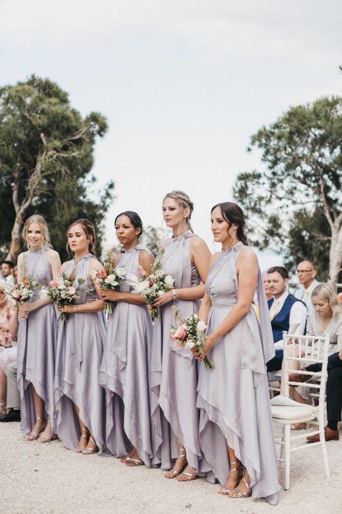 Bridesmaids in Silver Halterneck Dresses with Half Up Half Down Hemlines
