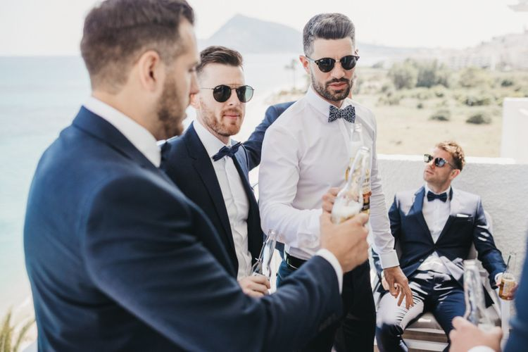 Groomsmen Sharing a Beer on the Wedding