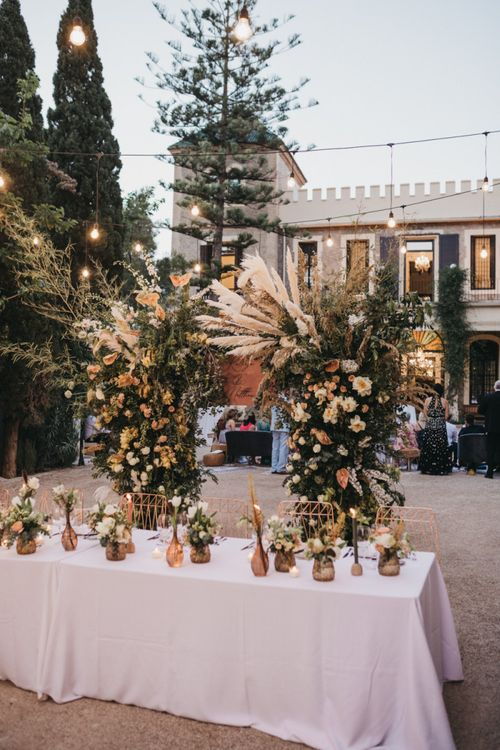 Intimate Top Table with Floral Arch Backdrop