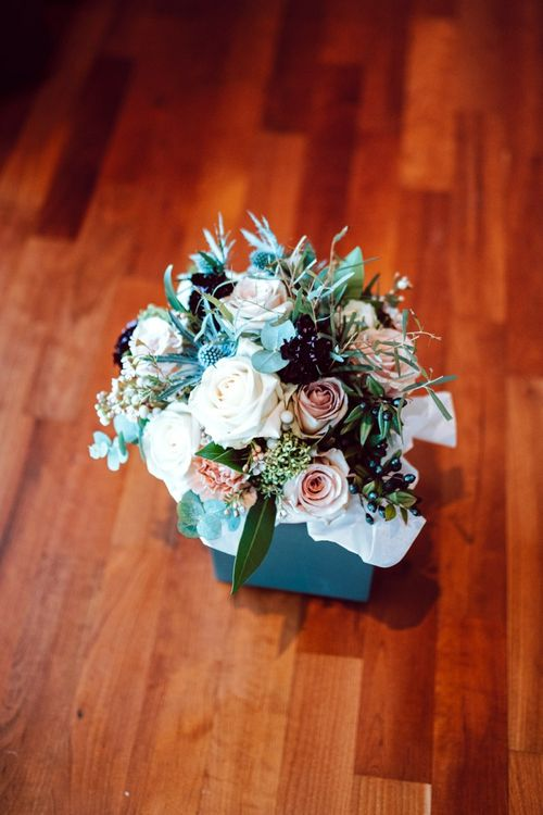 Wedding bouquet with heather and roses
