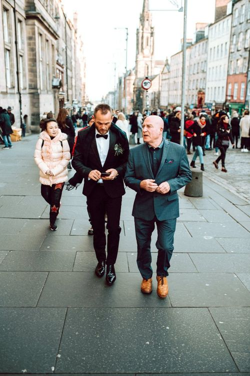 Groom and best man walking to the Edinburgh City Chambers wedding ceremony