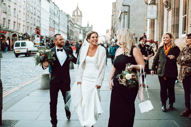 Bride and groom walking the city streets at Edinburgh elopement