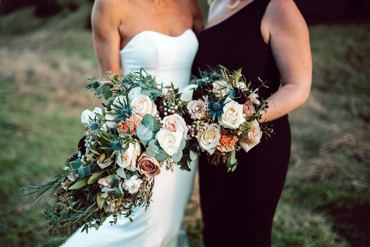 Winter wedding bouquet with roses, eucalyptus and heather
