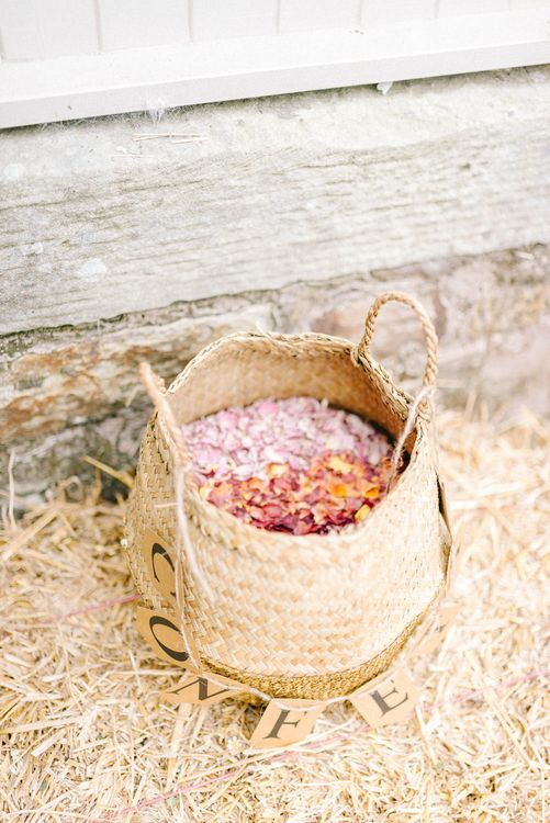 Confetti Petals in Wicker Basket | Colourful Paper Cranes & Sunflower Wedding Décor in Rustic Barn | Sarah-Jane Ethan Photography