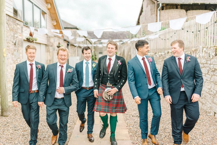 Groom in Blue Hugo Boss Suit with Dusty Blue Tie | Groomsmen in Blue Marks & Spencer Suits with Burgundy Ties | White Bunting | Colourful Paper Cranes & Sunflower Wedding Décor in Rustic Barn | Sarah-Jane Ethan Photography