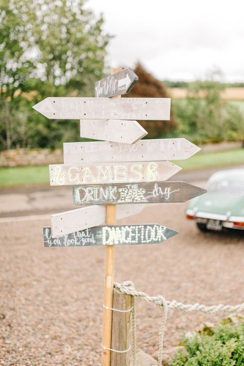 Wooden Wedding Sign at Doxford Barns | Colourful Paper Cranes & Sunflower Wedding Décor in Rustic Barn | Sarah-Jane Ethan Photography