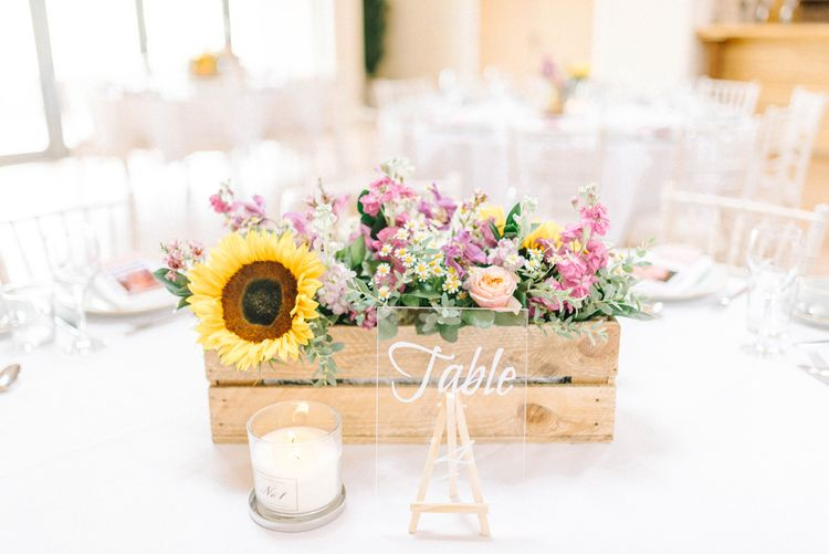 Wooden Flower Box with Sunflower | Acrylic Table Number | Scented Candle | Colourful Paper Cranes & Sunflower Wedding Décor in Rustic Barn | Sarah-Jane Ethan Photography
