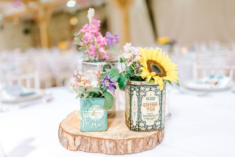 Table Centrepieces in Rustic Tea Jars | Log Slice | Colourful Paper Cranes & Sunflower Wedding Décor in Rustic Barn | Sarah-Jane Ethan Photography