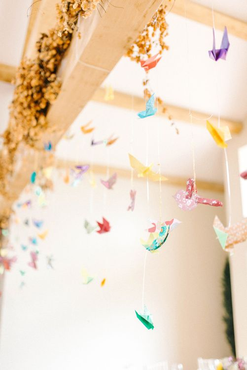 Paper Cranes Hanging from Barn Beams | Colourful Paper Cranes & Sunflower Wedding Décor in Rustic Barn | Sarah-Jane Ethan Photography