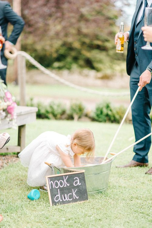 Hook a Duck Vintage Game at Wedding Reception | Colourful Paper Cranes & Sunflower Wedding Décor in Rustic Barn | Sarah-Jane Ethan Photography