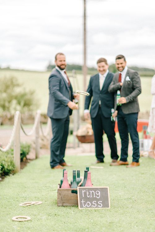 Ring Toss Garden Game at Wedding Reception | Colourful Paper Cranes & Sunflower Wedding Décor in Rustic Barn | Sarah-Jane Ethan Photography