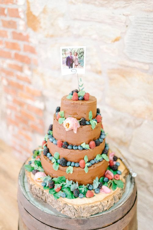 Four Tier Homemade Wedding Cake with Chocolate Icing and Berries | Polaroid Picture Cake Topper | Log Slice Base for Wedding Cake | Colourful Paper Cranes & Sunflower Wedding Décor in Rustic Barn | Sarah-Jane Ethan Photography