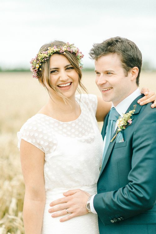Bride in Chiffon Polka Dot Dress by Kate Halfpenny | Bridal Flower Crown | Groom in Blue Hugo Boss Suit with Dusty Blue Tie | Bridal Plaited Up Do | Colourful Paper Cranes & Sunflower Wedding Décor in Rustic Barn | Sarah-Jane Ethan Photography