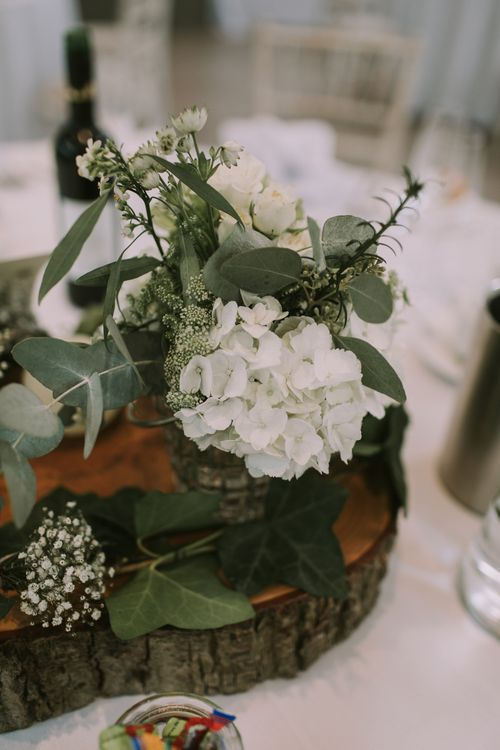 Table Decor | Flowers | Glass | Wood | Tyn Dwr Hall, North Wales | Justin Alexander Gown from Brides by Tina Louise | Photography by Livi Edwards.
