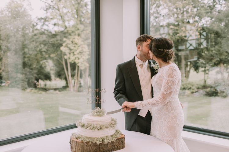 Cutting the Cake | Tyn Dwr Hall, North Wales | Justin Alexander Gown from Brides by Tina Louise | Photography by Livi Edwards.