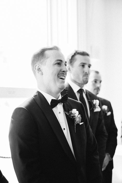 Wedding Ceremony | Groom at the Altar in Oscar Hunt Tuxedo | Elegant White, Green & Gold Wedding with Succulent & Foliage Decor at ICA in London City | Kylee Yee Fine Art Photography
