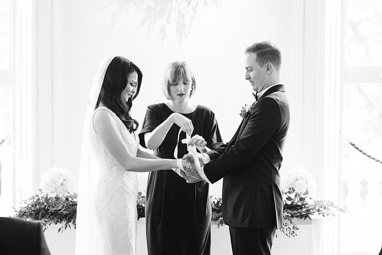 Hand Fastening Wedding Ceremony | Bride in Bespoke Wedding Dress | Groom in Oscar Hunt Tuxedo | Elegant White, Green & Gold Wedding with Succulent & Foliage Decor at ICA in London City | Kylee Yee Fine Art Photography