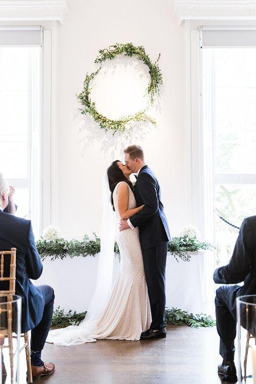 Wedding Ceremony | Bride in Bespoke Wedding Dress | Groom in Oscar Hunt Tuxedo | Elegant White, Green & Gold Wedding with Succulent & Foliage Decor at ICA in London City | Kylee Yee Fine Art Photography