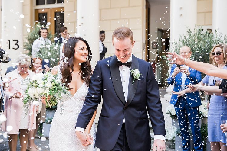 Confetti Exit | Bride in Bespoke Wedding Dress | Groom in Oscar Hunt Tuxedo | Elegant White, Green & Gold Wedding with Succulent & Foliage Decor at ICA in London City | Kylee Yee Fine Art Photography