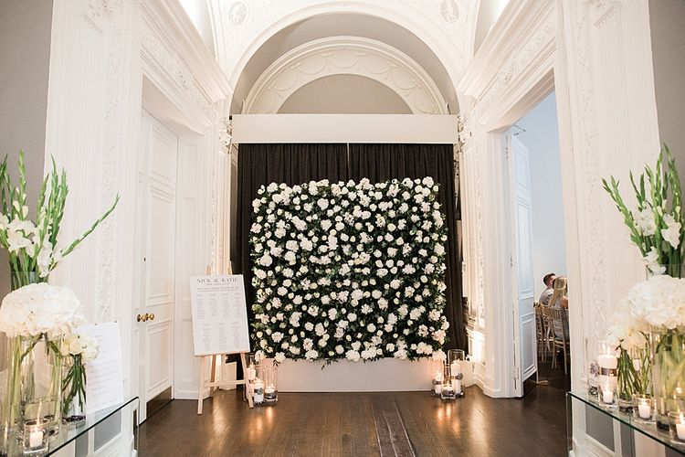 Flower Wall, Candle Light and Table Plan Wedding Decor | Elegant White, Green & Gold Wedding with Succulent & Foliage Decor at ICA in London City | Kylee Yee Fine Art Photography
