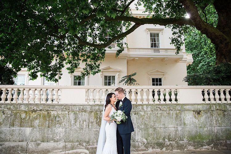Bride in Bespoke Embellished Gown | Groom in Tuxedo | Elegant White, Green & Gold Wedding with Succulent & Foliage Decor at ICA in London City | Kylee Yee Fine Art Photography