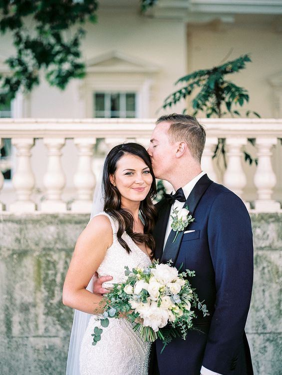 Bride in Bespoke Wedding Dress | Groom in Oscar Hunt Tuxedo | Elegant White, Green & Gold Wedding with Succulent & Foliage Decor at ICA in London City | Kylee Yee Fine Art Photography