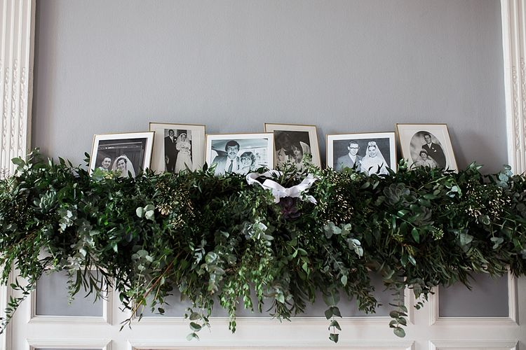 Foliage Mantle Piece Garland and Family Portraits | Wedding Decor | Elegant White, Green & Gold Wedding with Succulent & Foliage Decor at ICA in London City | Kylee Yee Fine Art Photography