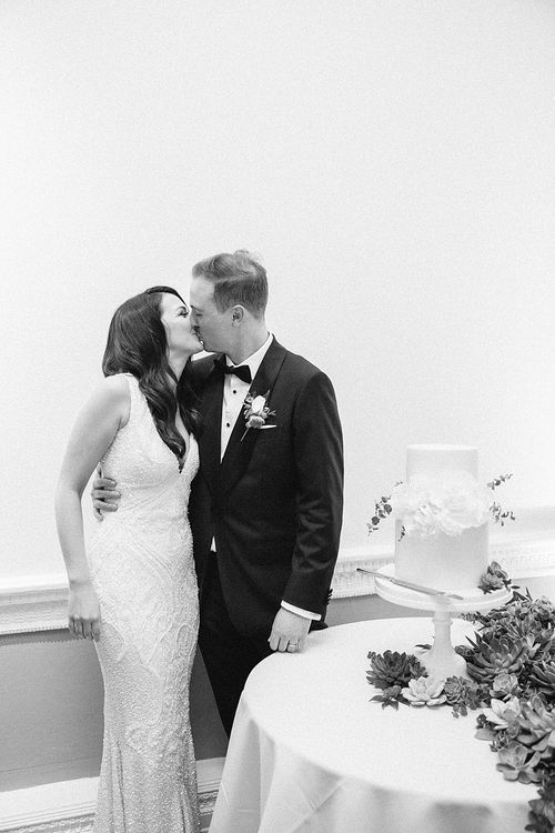 Bride & Groom Cutting the Cake | Elegant White, Green & Gold Wedding with Succulent & Foliage Decor at ICA in London City | Kylee Yee Fine Art Photography