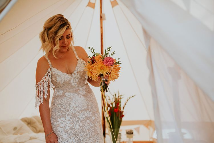 Bride in Grace Loves Lace wedding dress with bright bouquet