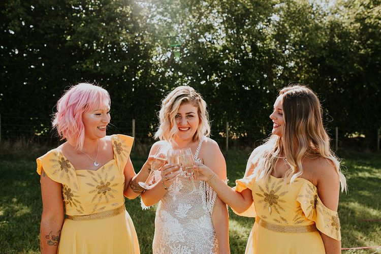 Canary yellow bridesmaid dresses with bright bouquets