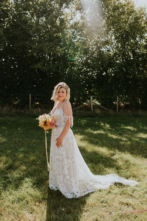 Bright wedding flowers with off-the-shoulder wedding dress