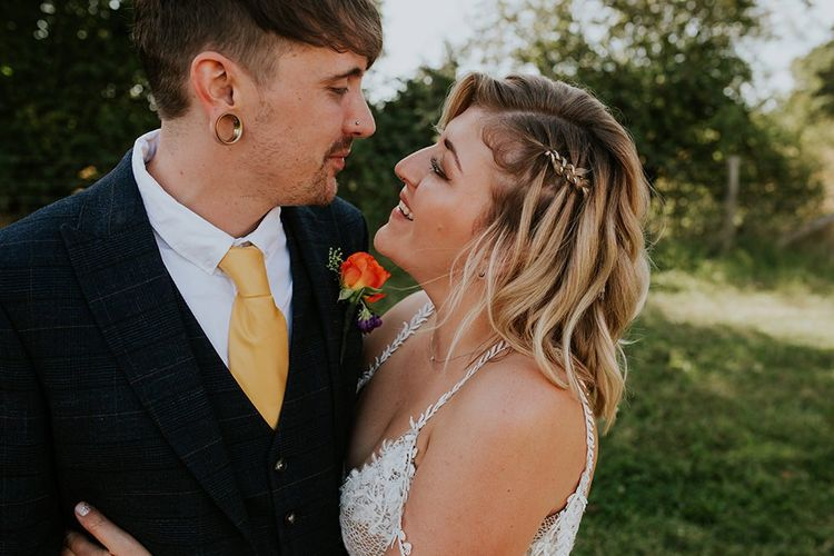 Bride and groom take a moment to themselves during festival style wedding