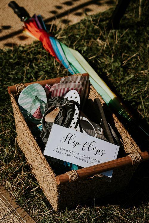 Flip flop basket for guests at festival style wedding