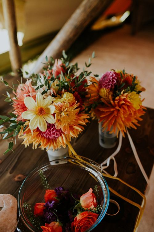Bright wedding flowers to match canary yellow bridesmaid dresses and bright decor