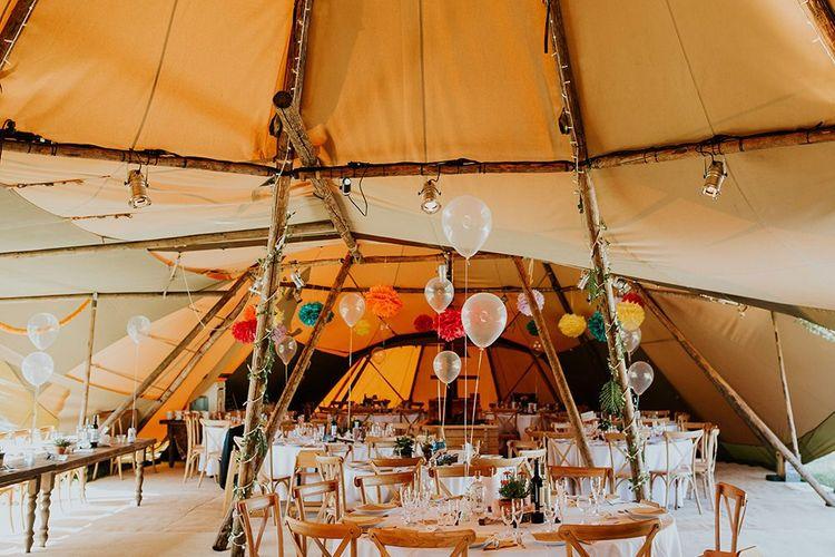 Wedding balloon centrepieces with multi-coloured pompom decor