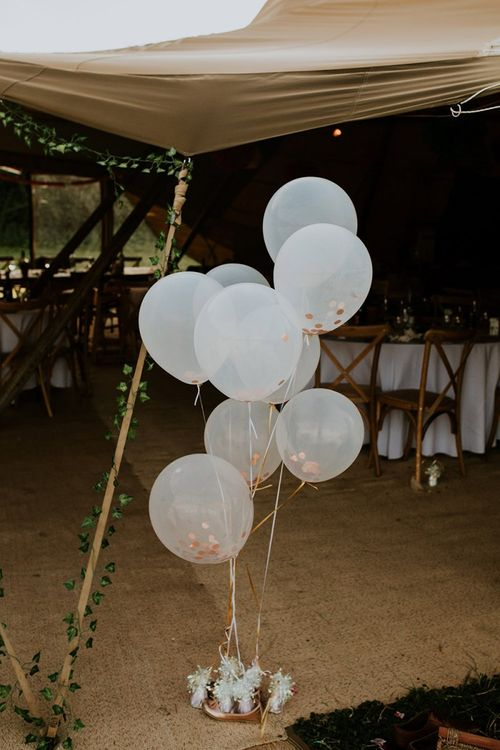 Wedding balloons at celebration with bright decor and canary yellow bridesmaid dresses