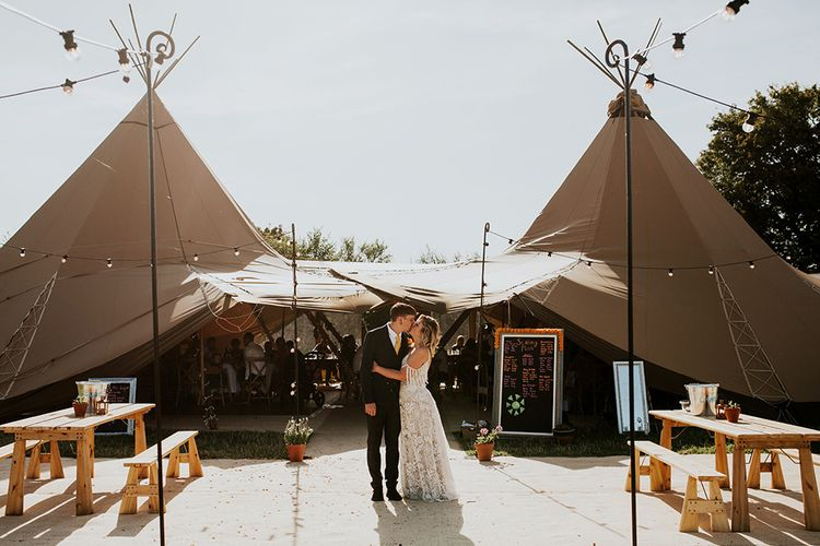 PapaKata tipi at festival style wedding with canary yellow bridesmaid dresses