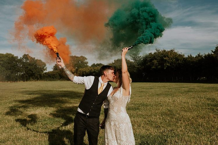 Bright wedding decor with colourful smoke bombs and canary yellow bridesmaid dresses