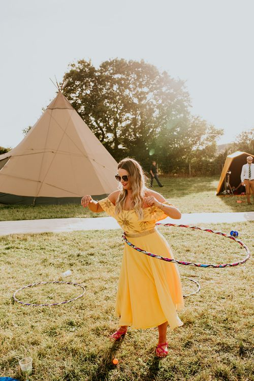 Canary yellow bridesmaid dresses and garden games at wedding