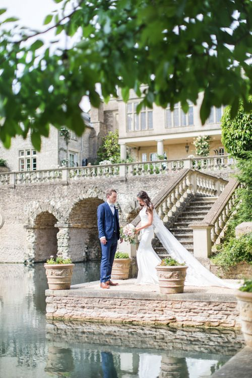 Bride and Groom Standing by the Mote of The Lost Orangery