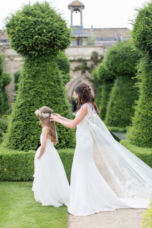Bride in Lace Wedding Dress and Cape with Flower Girl
